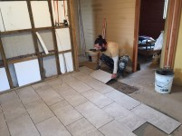 Cesar laying floor tiles